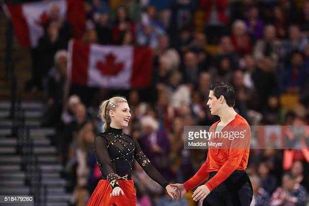 Piper Gilles and Paul Poirier of Canada celebrate after completing their routine in the Free Dance Program during Day 4 of the ISU World Figure...