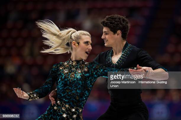 Piper Gilles and Paul Poirier of Canada compete in the Pairs Free Skating during day two of the World Figure Skating Championships at Mediolanum...