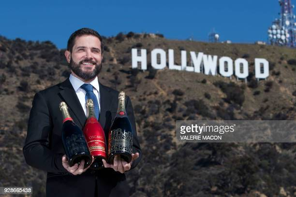 TOPSHOT Piper Heidsieck Global Executive Director Benoit Collard poses for portraits in front of the Hollywood Sign with the limited editions of the...