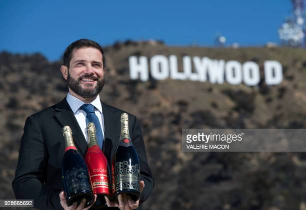 Piper Heidsieck Global Executive Director Benoit Collard poses for portraits in front of the Hollywood Sign with the limited editions of the Oscars...