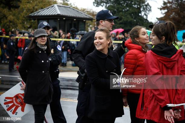 "Piper Perabo and Diane Lane are arrested near the US Capitol during ""Fire Drill Friday"" climate change protest on November 22, 2019 in Washington,..."