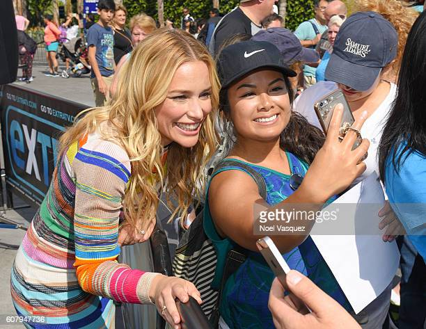 Piper Perabo takes a selfie with a fan at Extra at Universal Studios Hollywood on September 19 2016 in Universal City California