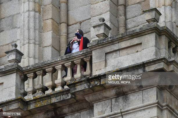 A piper plays a bagpiper from the terrace of the Ourense Cathedral in memory of the coronavirus victims on July 1 2020 As Europe begins its cautious...