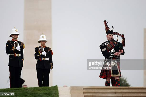 A piper plays a lament during the dedication of The Armed Forces Memorial attended by The Queen on October 12 Lichfield EnglandThe six million GBP...