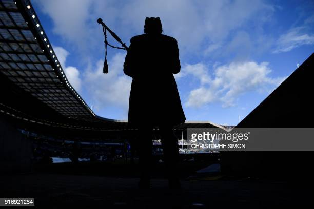 TOPSHOT A piper plays ahead of kick off of the Six Nations international rugby union match between Scotland and France at Murrayfield Stadium in...