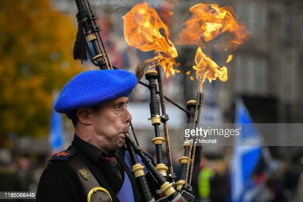 A piper plays as flames appear from his bagpipes while Independence supporters gather at an IndyRef2 rally in George Square on November 2 2019 in...
