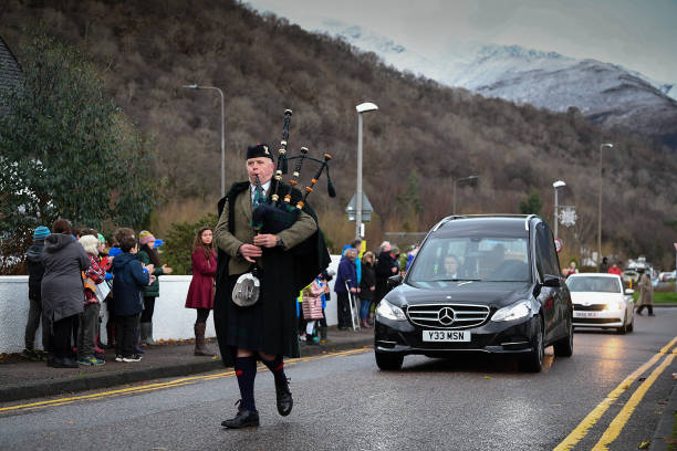 GBR: Funeral Cortege Of Famous Mountaineer Hamish MacInnes Mays Its Way From Glencoe