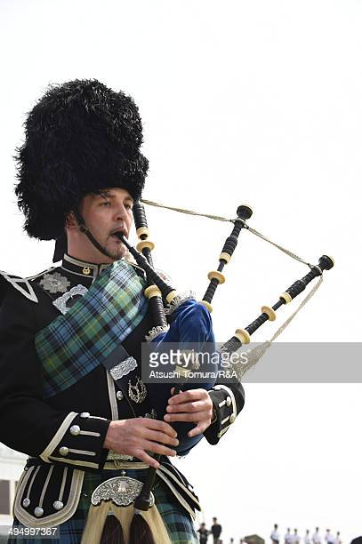 Piper plays bagpipes in the Presentation Ceremony for the Quailifiers during day two of the Mizuno Open at the Setonaikai Golf Club on June 1 2014 in...
