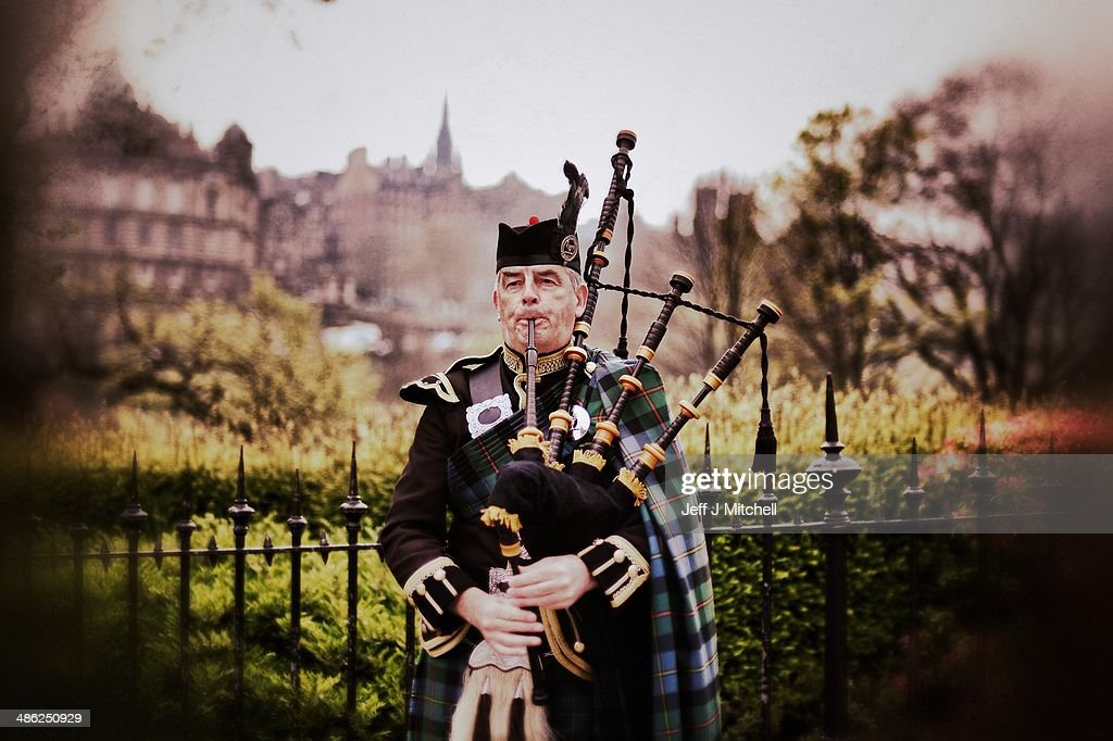 A piper plays on Princess Street on April 23, 2014 in Edinburgh, Scotland. A referendum on whether Scotland should be an independent country will take place on September 18, 2014.