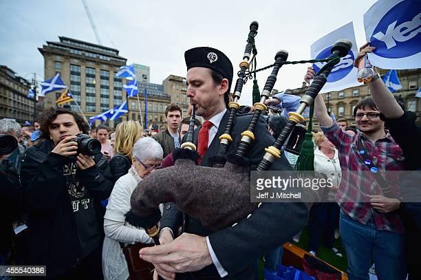 A piper plays to hundreds of Yes supporters gathered in George Square to show their support for the independence referendum on September 16 2014 in...