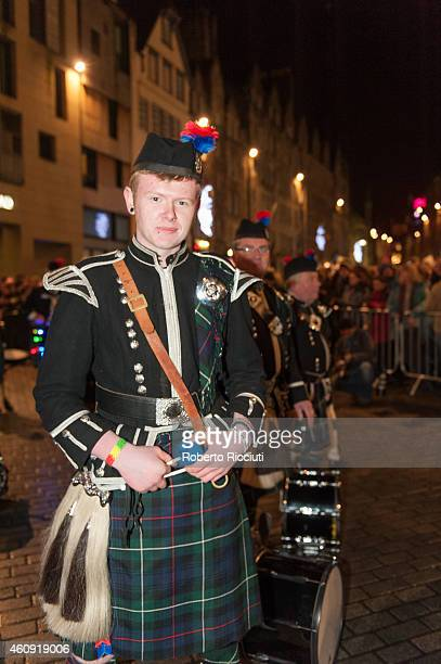 A piper takes part in the torchlight procession as it makes its way through Edinburgh for the start of the Hogmanay celebrations on December 30 2014...