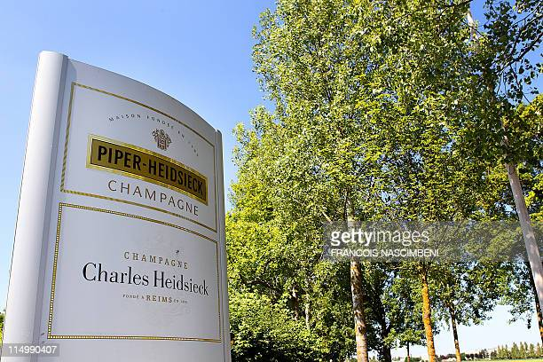 Piper-Heidsieck sign is displayed at the entrance of the Remy Cointreau company headquarters, near the French northeastern city of Reims, on June 1,...