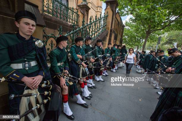 Pipers from Scott's College wait to lead the funeral cortege along College Street The funeral service for AC/DC cofounder Malcolm Young at St Mary's...