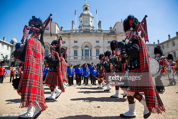 Pipers from the Scots Guards take part in an Act of Reverence featuring a set of 100yearold bagpipes at Horse Guards Parade on May 4 2016 in London...