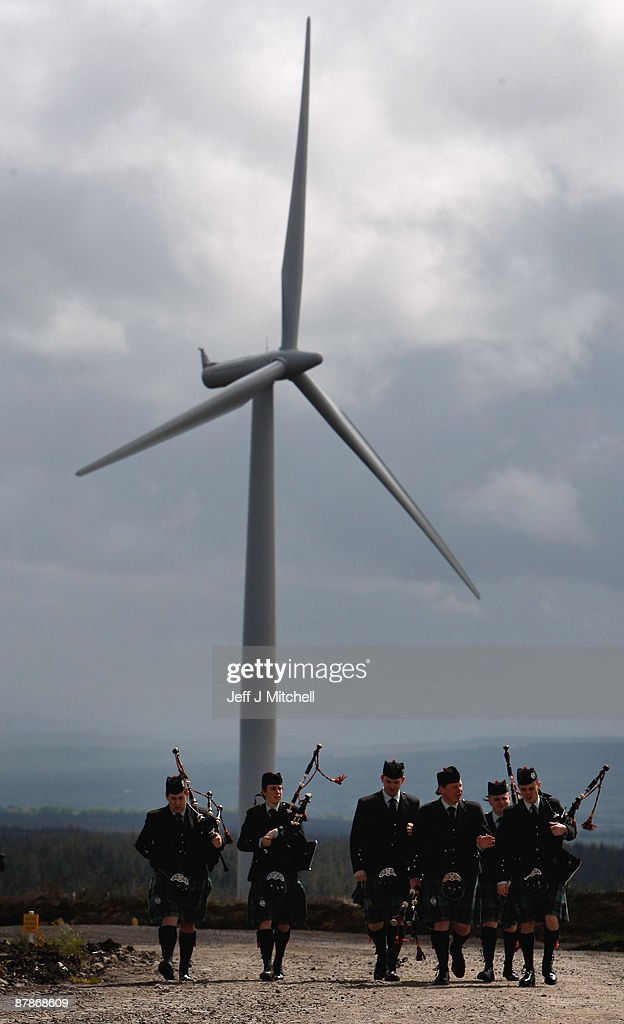 Pipers from the Scottish Power pipe band attend the switch on of Whitelee, Europe's largest onshore windfarm, as it officially opens on May 20, 2009 in Eaglesham, Scotland. The Whitelee wind farm will power 180,000 homes and has plans granted by the Scottish Government to power a further 70,000.