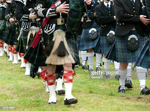 pipers in a marching band, scotland - highland games stock pictures, royalty-free photos & images