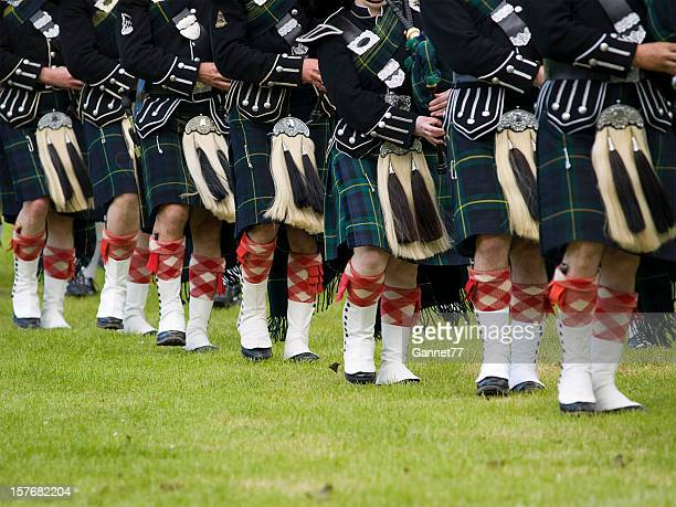 pipers in a marching band, scotland - kilt stock photos and pictures