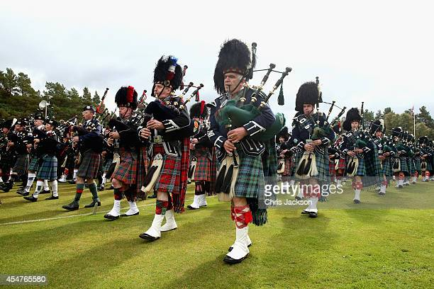 Pipers march during the Braemar Highland Games on September 6 2014 in Braemar Scotland The Braemar Gathering is the most famous of the Highland Games...