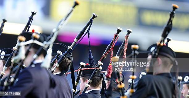 Pipers play bagpipes on the pitch ahead of the 6 Nations International rugby union match between Scotland and Ireland at Murrayfield Stadium in...