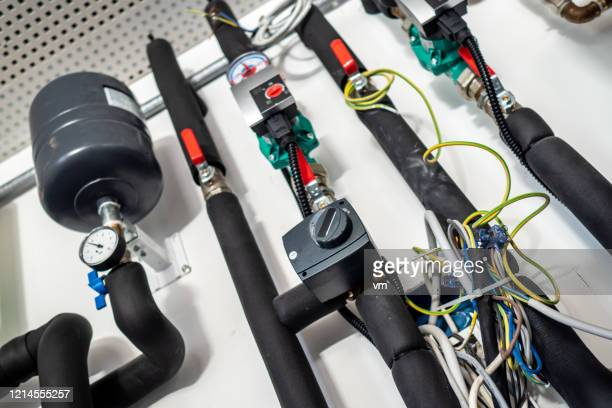 pipes and valves - water pump stock pictures, royalty-free photos & images