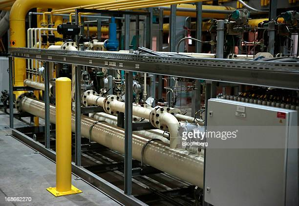 Pipes and valves stand on the Continuous Annealing Line at the PROTEC Coating Co facility in Leipsic Ohio US on Monday May 13 2013 PROTEC Coating Co...