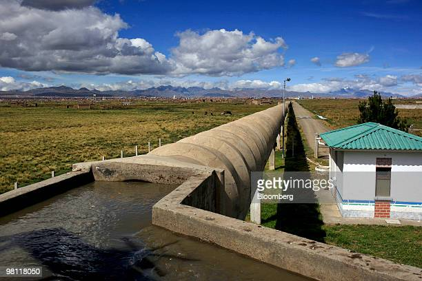 Pipes carry water treated at the stateowned Empresa Publica Social del Agua y Saneamiento SA Puchuckollo treatment facility in Viacha Bolivia on...