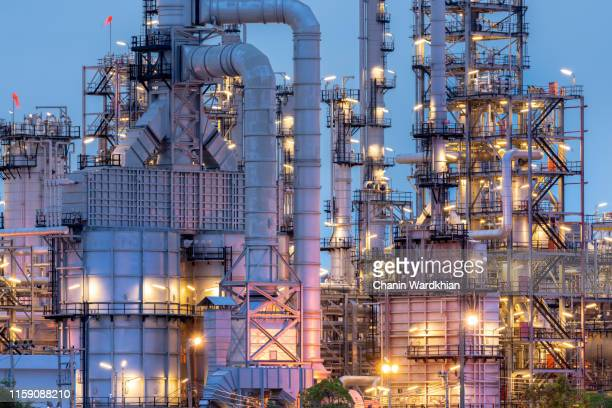 pipes, complex industrial piping at oil refinery - oil refinery stock pictures, royalty-free photos & images