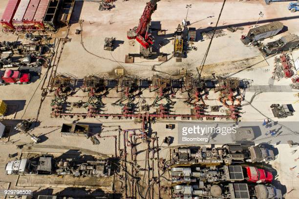 Pipes connect six Chevron Corp oil wells being readied for hydraulic fracturing in the Permian Basin in this aerial photograph taken near Midland...