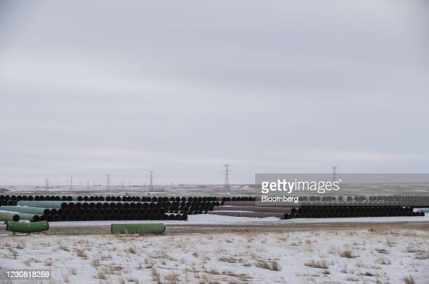 Pipes for the Keystone XL pipeline stacked in a yard near Oyen, Alberta, Canada, on Tuesday, Jan. 26, 2021. U.S. President Joe Biden revokedthe...