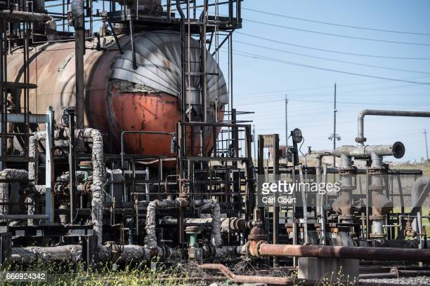Pipes lie in ruins at an oil refinery destroyed by retreating Islamic State fighters at the beginning of the Mosul offensive on April 10 2017 in...
