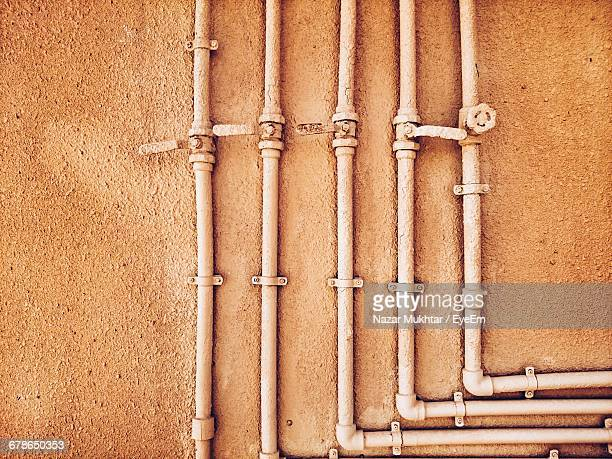 pipes on brown wall - nazar stock photos and pictures