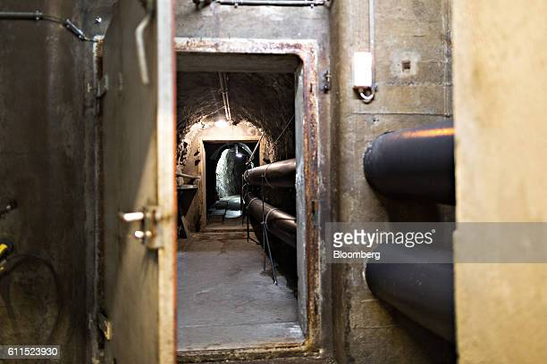 Pipes run inside a tunnel leading to a vault inside the Swiss Data Safe AG formermilitary bunker secure storage facility in Amsteg Switzerland on...
