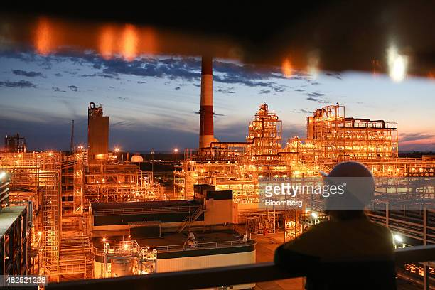 Pipework sits illuminated at night in the crude oil processing facility at the 'TANECO' refining and petrochemical plant operated by Tatneft OAO in...