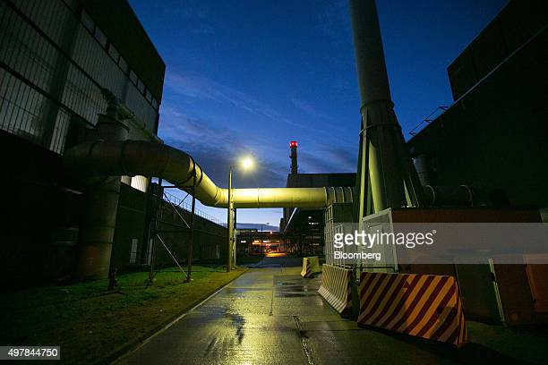 Pipework stands illuminated at dusk outside Lubmin nuclear power plant during decommissioning operations in Greifswald Germany on Wednesday Nov 18...