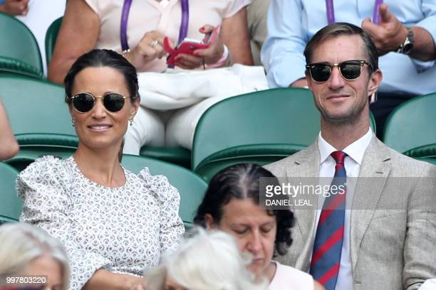 Pippa and James Matthews arrive on centre court to watch South Africa's Kevin Anderson play US player John Isner in their men's singles semifinal...