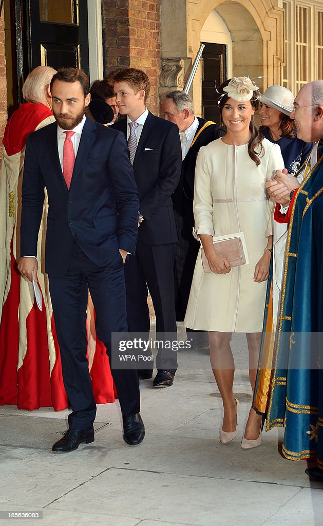 Pippa and James Middleton leave the Chapel Royal in St James's Palace, after the christening of the three month-old Prince George of Cambridge by the Archbishop of Canterbury on October 23, 2013 in London, England.