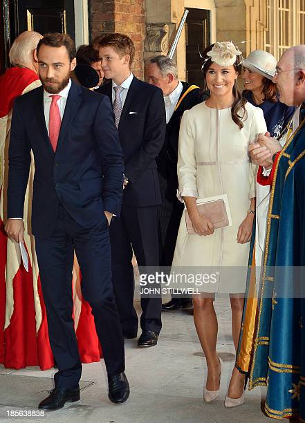 Pippa and James Middleton leave the Chapel Royal in St James's Palace in central London after attending the Christening of Prince George of Cambridge...