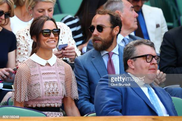 Pippa and James Middleton look on from the centre court royal box on day three of the Wimbledon Lawn Tennis Championships at the All England Lawn...
