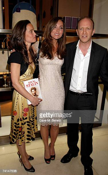 Pippa and Kate Middleton pose with journalist Simon Sebag Montefiore at the book launch party of The Young Stalin The Adventurous Early Life Of The...