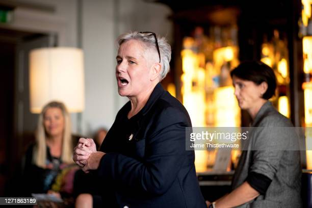 """Pippa Dale introduces the Cast and Crew panel during the """"Henpire"""" podcast launch event at Langham Hotel on September 10, 2020 in London, England."""