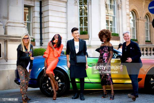 """Pippa Dale, Jacquie Lawrence, Sinitta, Vincent Wong and Heather Small pose with the rainbow Bentley during the """"Henpire"""" podcast launch event at..."""