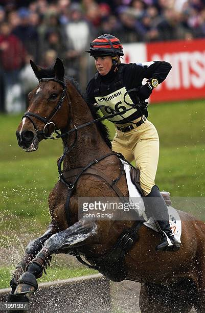 Pippa Funnell of Great Britain on Supreme Rock clears the Lake with ease to finish in top position after the cross country stage during the 2003...