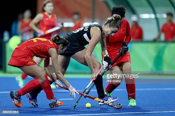 Pippa Hayward of New Zealand takes the ball past Na Wang of China in the Women's Pool A match between the People's Republic of China and New Zealand...