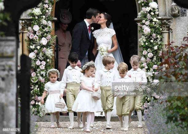 Pippa Matthews and James Matthews exit the church after their wedding ceremony at St Mark's Church on May 20, 2017 in Englefield Green, England.