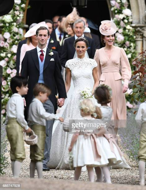 Pippa Matthews and James Matthews exit the church after their wedding ceremony followed by Catherine, Duchess of Cambridge at St Mark's Church on May...