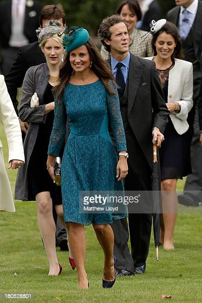 Pippa Middelton attends the wedding of James Meade and Lady Laura Marsham at The Parish Church of St Nicholas in Gaytonon September 14 2013 in King's...