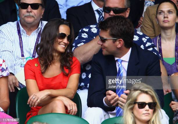 Pippa Middleton and Alex Loudon attend the quarterfinal round match between Roger Federer of Switzerland and JoWilfried Tsonga of France on Day Nine...