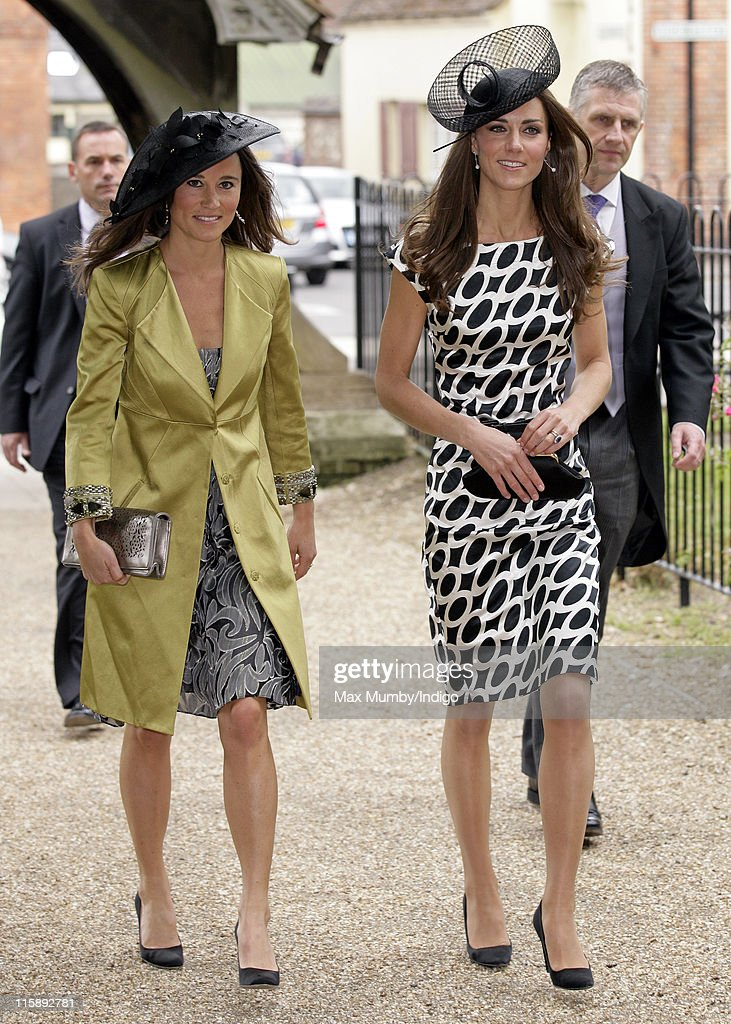 Pippa Middleton and Catherine, Duchess of Cambridge attend the wedding of Sam Waley-Cohen and Annabel Ballin at St. Michael and All Angels church on June 11, 2011 in Lambourn, England.