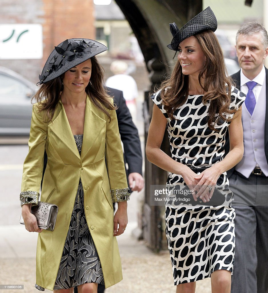 Pippa Middleton and Catherine Duchess of Cambridge attend the wedding of Sam Waley-Cohen and Annabel Ballin at St. Michael and All Angels church on June 11, 2011 in Lambourn, England.
