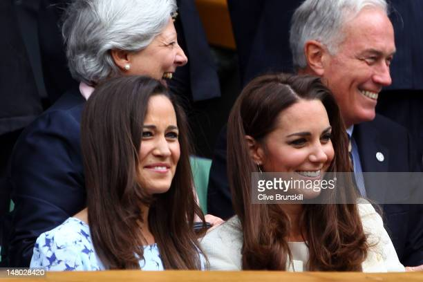 Pippa Middleton and Catherine, Duchess of Cambridge sit in the Royal Box during the Gentlemen's Singles final match between Roger Federer of...